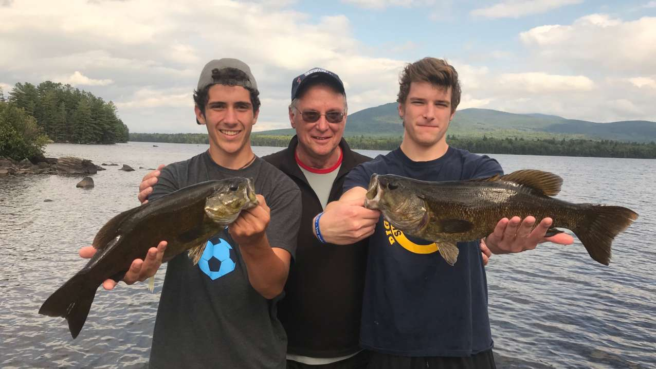 The dog days of summer are all about guided smallmouth bass trips in Maine